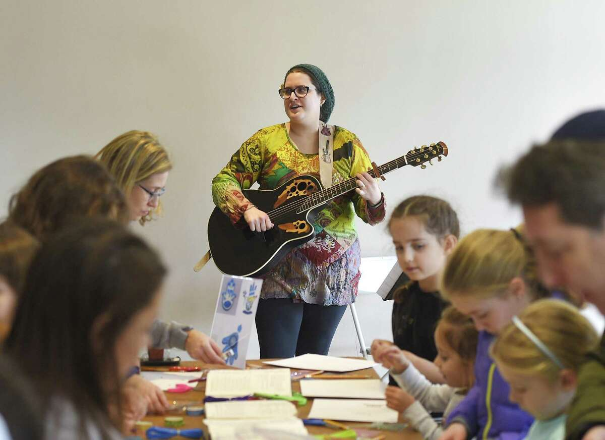 Rabbi Chaya Bender plays music from Tzfat during the interactive