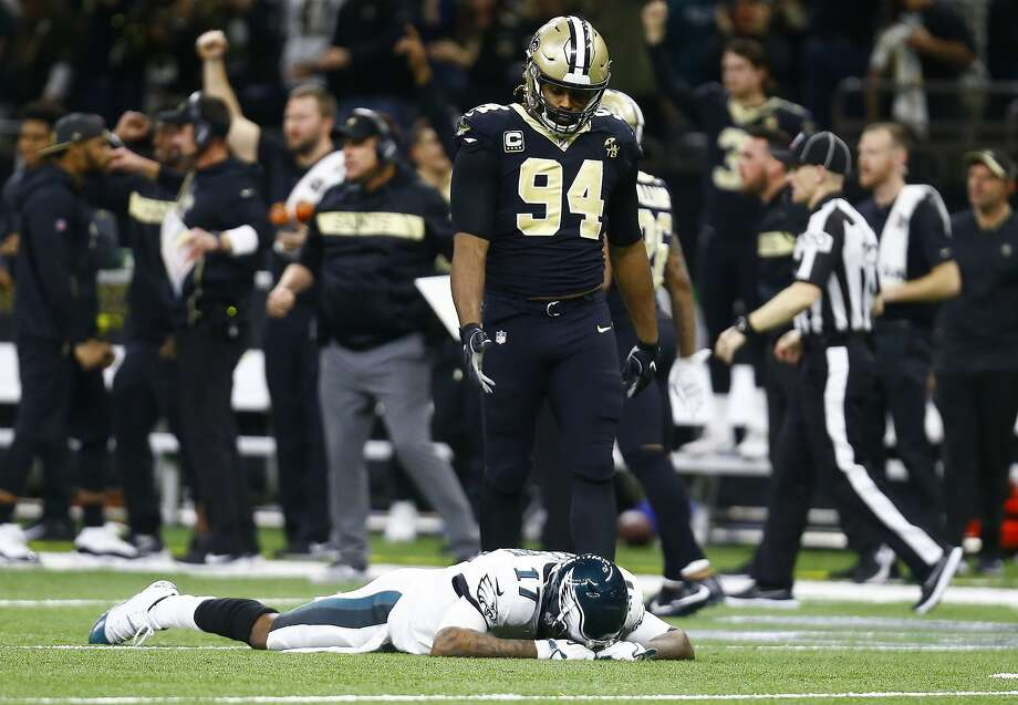 Eagles receiver Alshon Jeffery lies on the turf after a game-sealing Saints interception on a pass that deflected off his hands. Photo: Butch Dill / Associated Press
