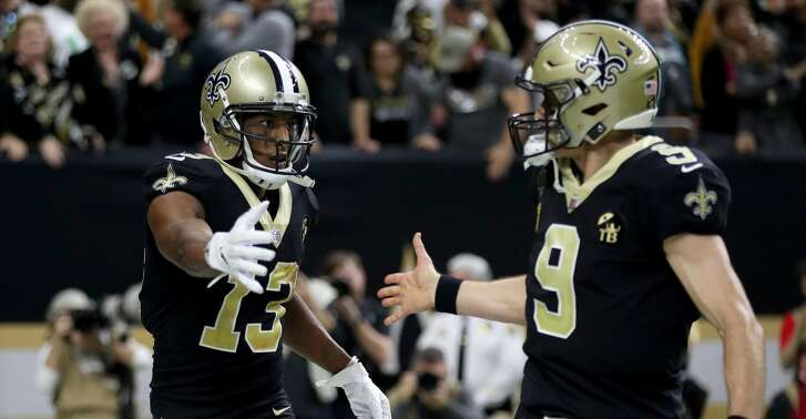 NEW ORLEANS, LOUISIANA - JANUARY 13:  Michael Thomas #13 and Drew Brees #9 of the New Orleans Saints celebrate their third quarter touchdown against the Philadelphia Eagles in the NFC Divisional Playoff Game at Mercedes Benz Superdome on January 13, 2019 in New Orleans, Louisiana. (Photo by Chris Graythen/Getty Images)