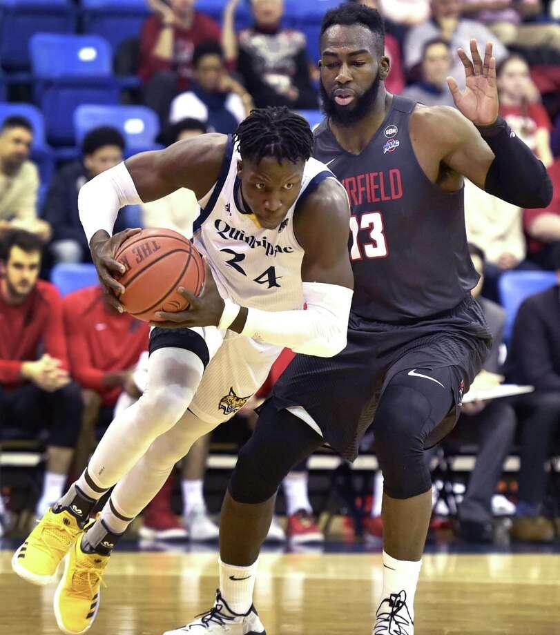 Quinnipiac's Abdulai Bundu drives to the basket against Fairfield's Jonathan Kasibabu on Sunday. Photo: Peter Hvizdak / Hearst Connecticut Media / New Haven Register
