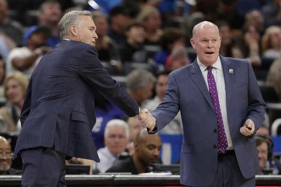 Houston Rockets head coach Mike D'Antoni, left, greets Orlando Magic head coach Steve Clifford during the first half of an NBA basketball game, Sunday, Jan. 13, 2019, in Orlando, Fla. (AP Photo/John Raoux)