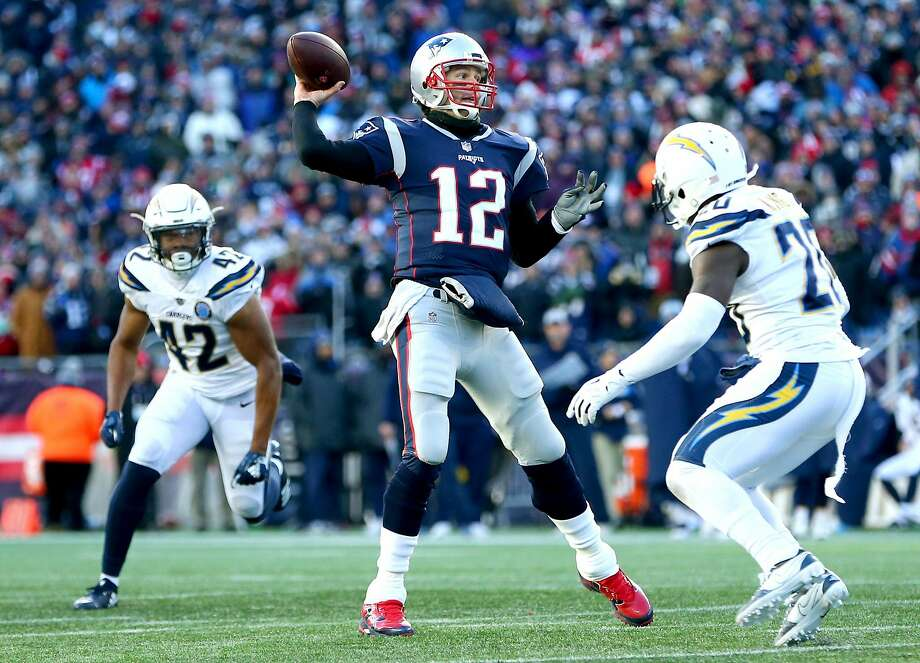 FOXBOROUGH, MASSACHUSETTS - JANUARY 13: Tom Brady #12 of the New England Patriots throws during the third quarter in the AFC Divisional Playoff Game  against the Los Angeles Chargers at Gillette Stadium on January 13, 2019 in Foxborough, Massachusetts. (Photo by Adam Glanzman/Getty Images) Photo: Adam Glanzman, Getty Images