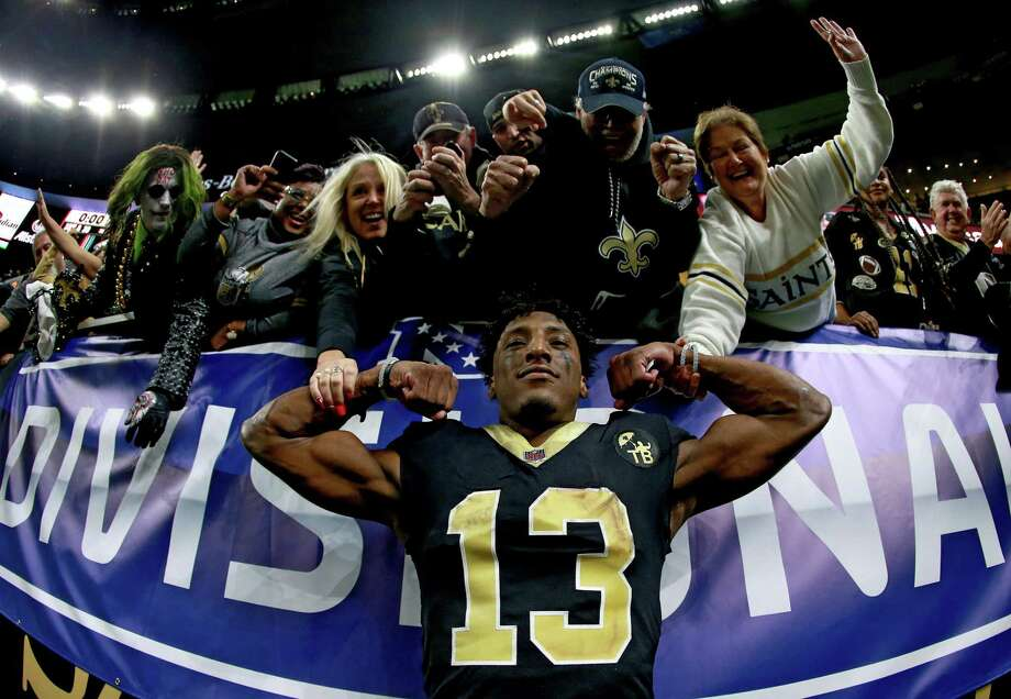 Michael Thomas #13 of the New Orleans Saints posses for a photo with the fans after his teams win over the Philadelphia Eagles in the NFC Divisional Playoff Game at Mercedes Benz Superdome on January 13, 2019 in New Orleans, Louisiana. Photo: Sean Gardner, Stringer / Getty Images / 2019 Getty Images