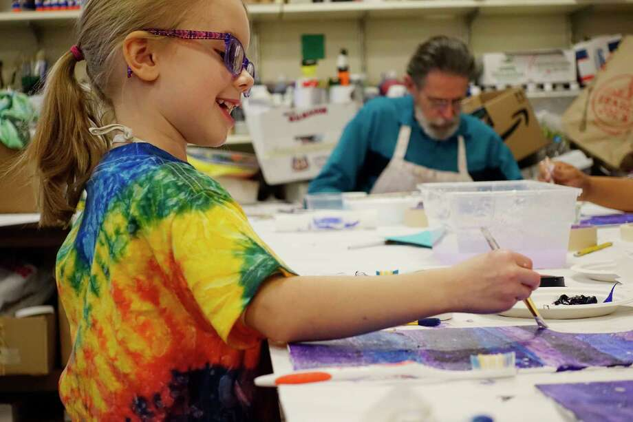 Skyler Hill, 6, of Albany paints a moon on her canvas during the Family Painting Workshop at the Albany Institute of History & Art on Sunday, Jan. 13, 2019, in Albany, N.Y. The institute also runs their Art for All program on most Saturdays, and on February 7th the museum will be hosting their Adult Coloring Night. On February 19th through the 21st the institute will hold their Lively Lines program, a school vacation break art program.  (Paul Buckowski/Times Union) Photo: Paul Buckowski / (Paul Buckowski/Times Union)