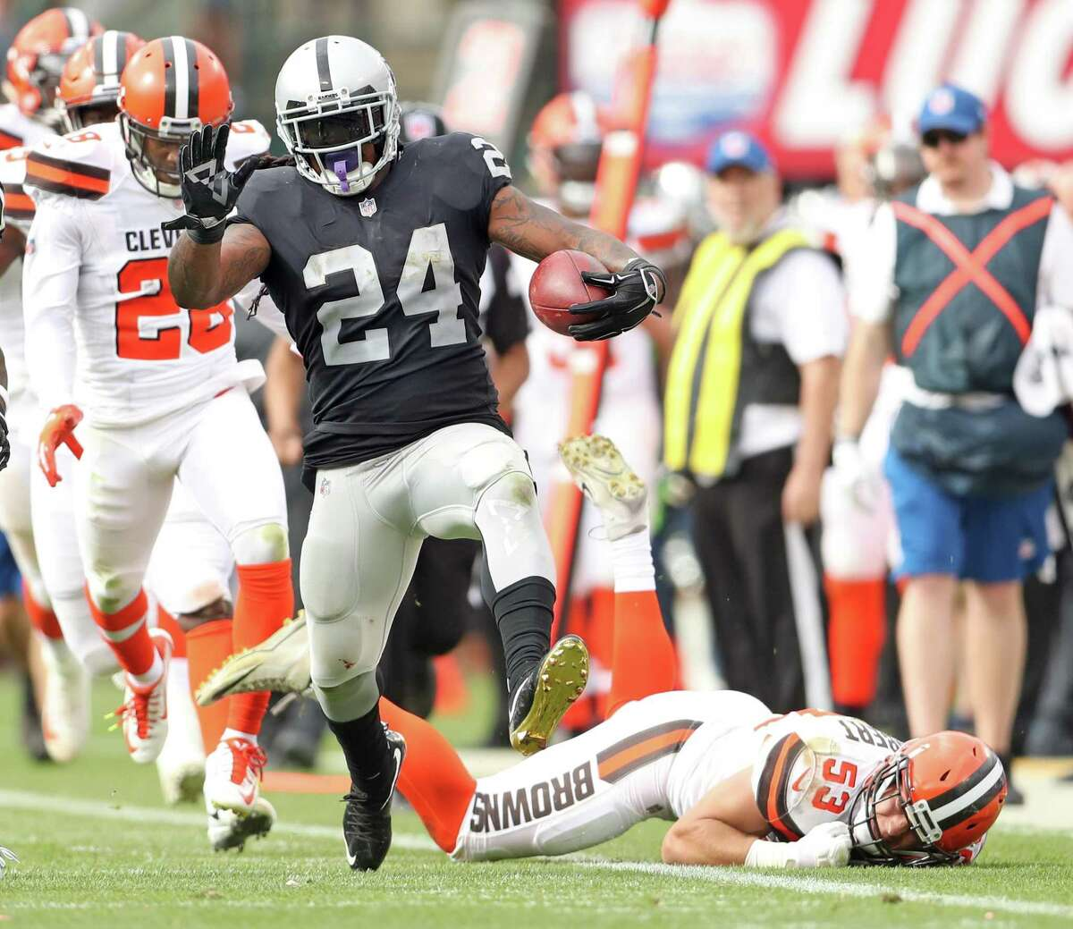 Oakland Raiders' Marshawn Lynch during his 52-yard run in 3rd quarter of 45-42 overtime win over Cleveland Browns during NFL game at Oakland Coliseum in Oakland, Calif. on Sunday, September 30, 2018.