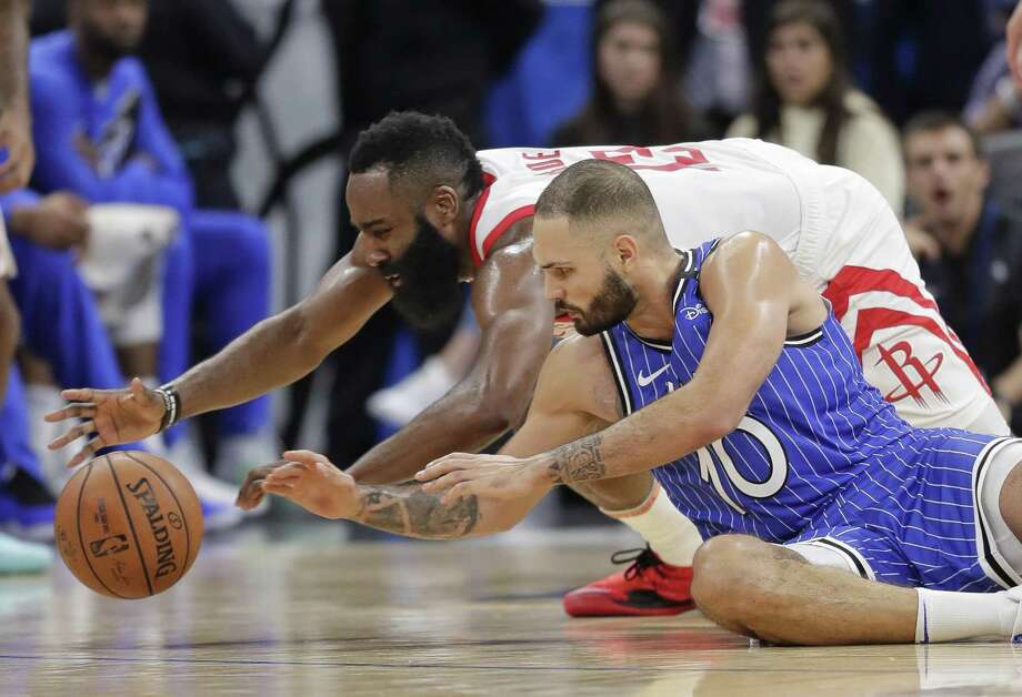 Houston Rockets' James Harden, left, and Orlando Magic's Evan Fournier (10) go after the ball during the second half of an NBA basketball game, Sunday in Orlando, Fla. Photo: John Raoux, STF / Associated Press / Copyright 2019 The Associated Press. All rights reserved
