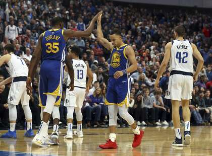 9fcf947c6 Golden State Warriors forward Kevin Durant (35) high-fives guard Stephen  Curry (30) near the end of an NBA basketball game against the Dallas  Mavericks