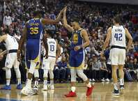 Golden State Warriors forward Kevin Durant (35) high-fives guard Stephen Curry (30) near the end of an NBA basketball game against the Dallas Mavericks, Sunday, Jan. 13, 2019, in Dallas. (AP Photo/Richard W. Rodriguez)
