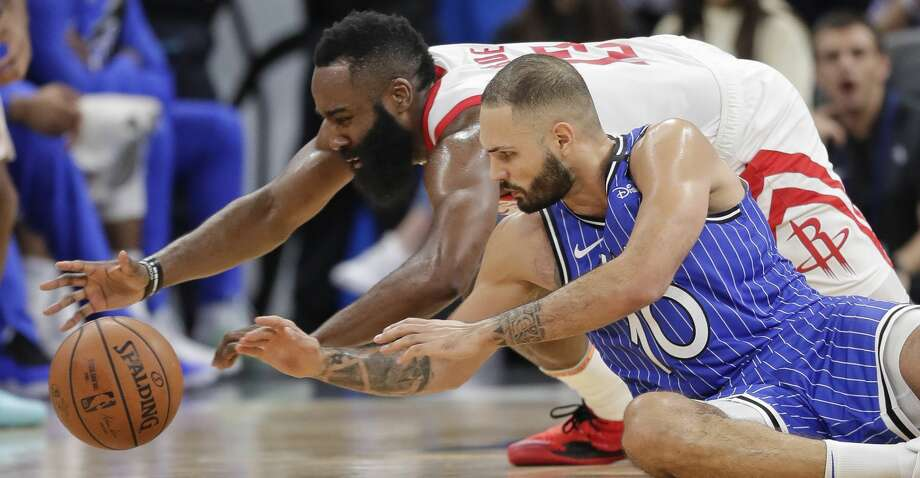 Houston Rockets' James Harden, left, and Orlando Magic's Evan Fournier (10) go after the ball during the second half of an NBA basketball game, Sunday, Jan. 13, 2019, in Orlando, Fla. (AP Photo/John Raoux) Photo: John Raoux/Associated Press