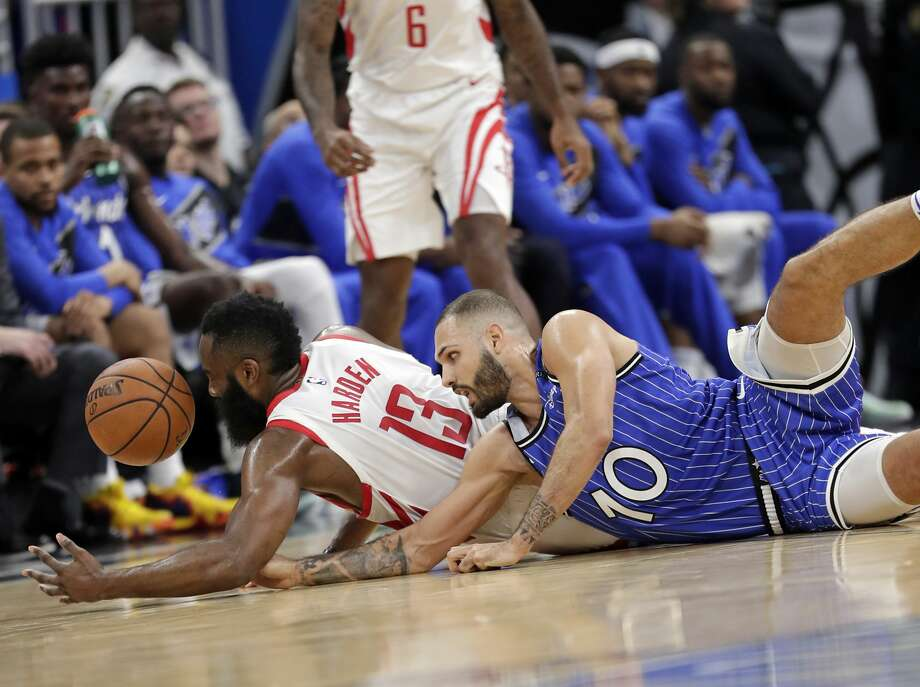 Houston Rockets' James Harden, left, and Orlando Magic's Evan Fournier go after a loose ball during the second half of an NBA basketball game, Sunday, Jan. 13, 2019, in Orlando, Fla. (AP Photo/John Raoux) Photo: John Raoux/Associated Press