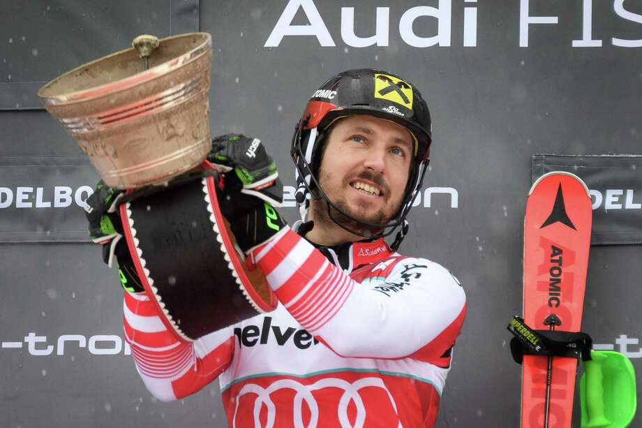 Austria's Marcel Hirscher celebrates on the podium after winning the Men's slalom race at the FIS Alpine Skiing World Cup on January 13, 2019 in Adelboden. (Photo by Fabrice COFFRINI / AFP)FABRICE COFFRINI/AFP/Getty Images Photo: FABRICE COFFRINI / AFP or licensors