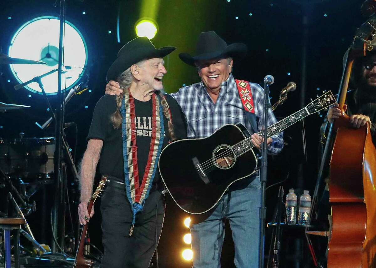 Willie Nelson, left, and George Strait perform at Willie: Life & Songs Of An American Outlaw at Bridgestone Arena on Saturday, Jan. 12, 2019, in Nashville, Tenn. (Photo by Al Wagner/Invision/AP)
