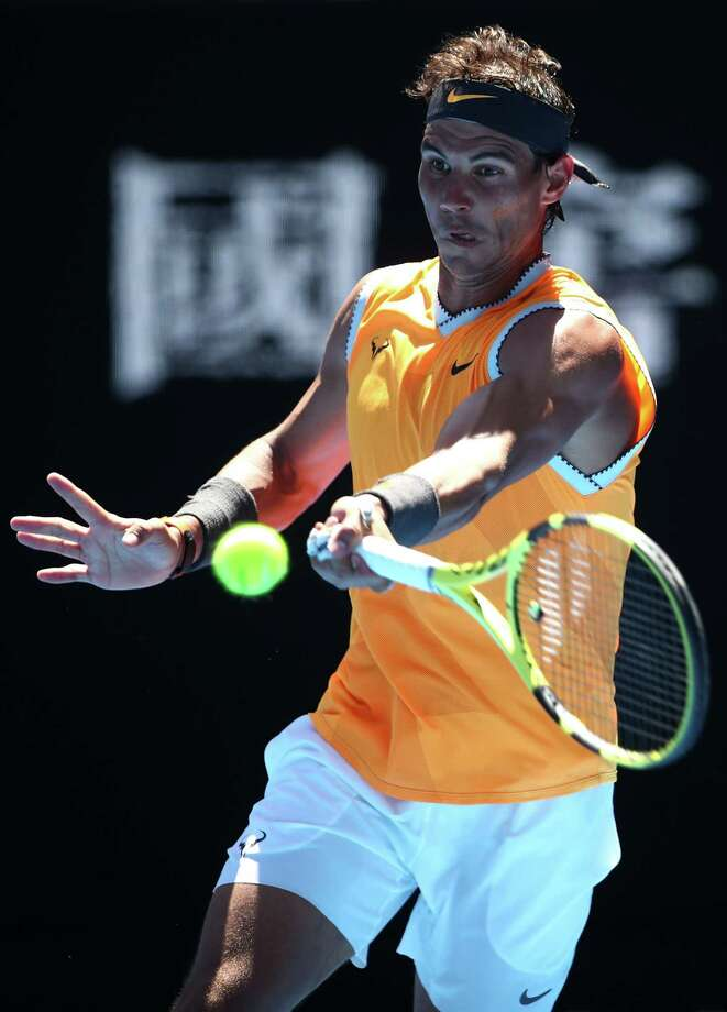 MELBOURNE, AUSTRALIA - JANUARY 14:  Rafael Nadal of Spain plays a forehand in his first round match against James Duckworth of Australia during day one of the 2019 Australian Open at Melbourne Park on January 14, 2019 in Melbourne, Australia.  (Photo by Julian Finney/Getty Images) Photo: Julian Finney / 2019 Getty Images
