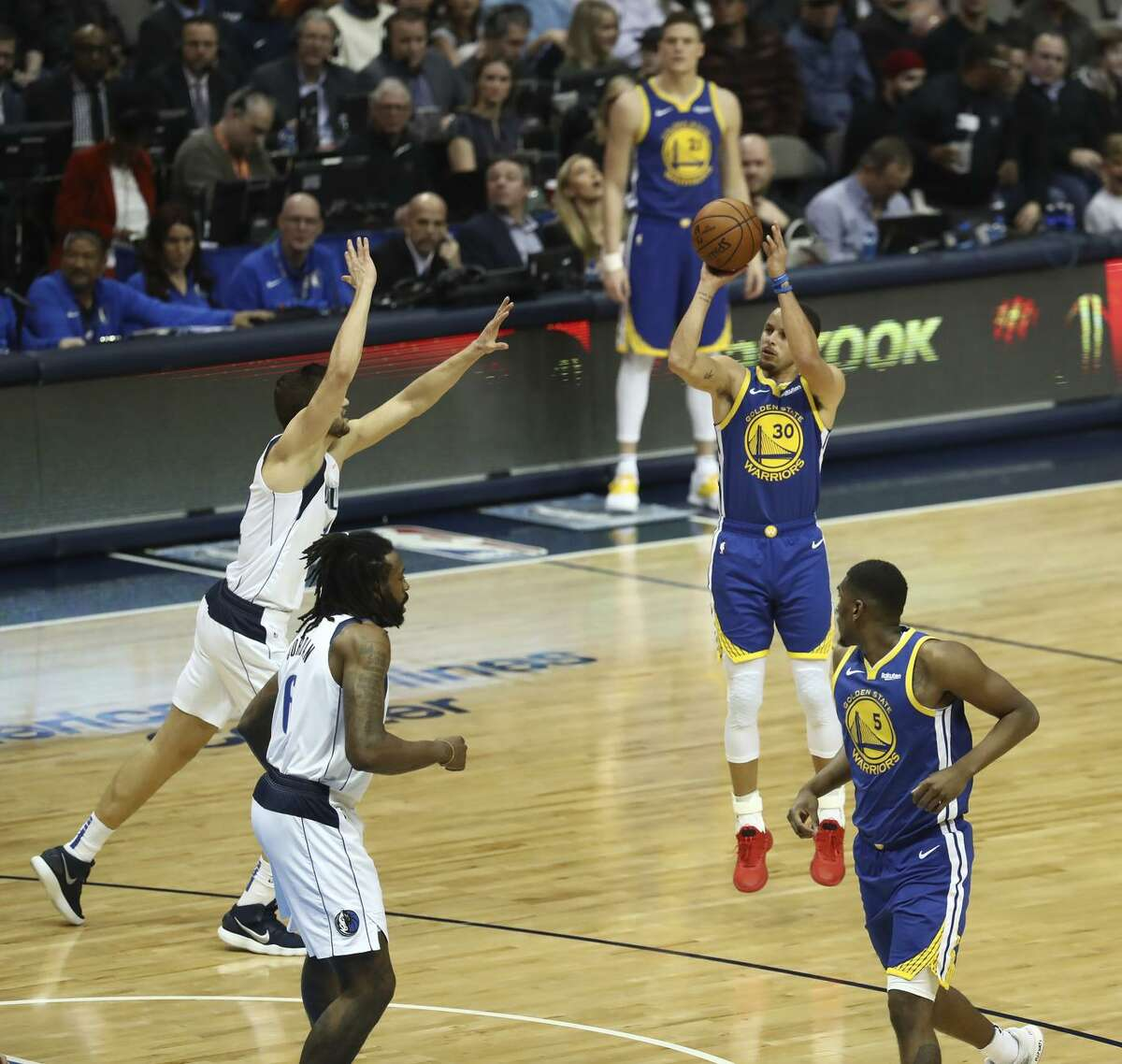 Stephen Curry launches a jump shot against the Mavericks. He hit 11 3-pointers and scored 48 points, figures that could help him rejoin the conversation about potential MVP candidates.