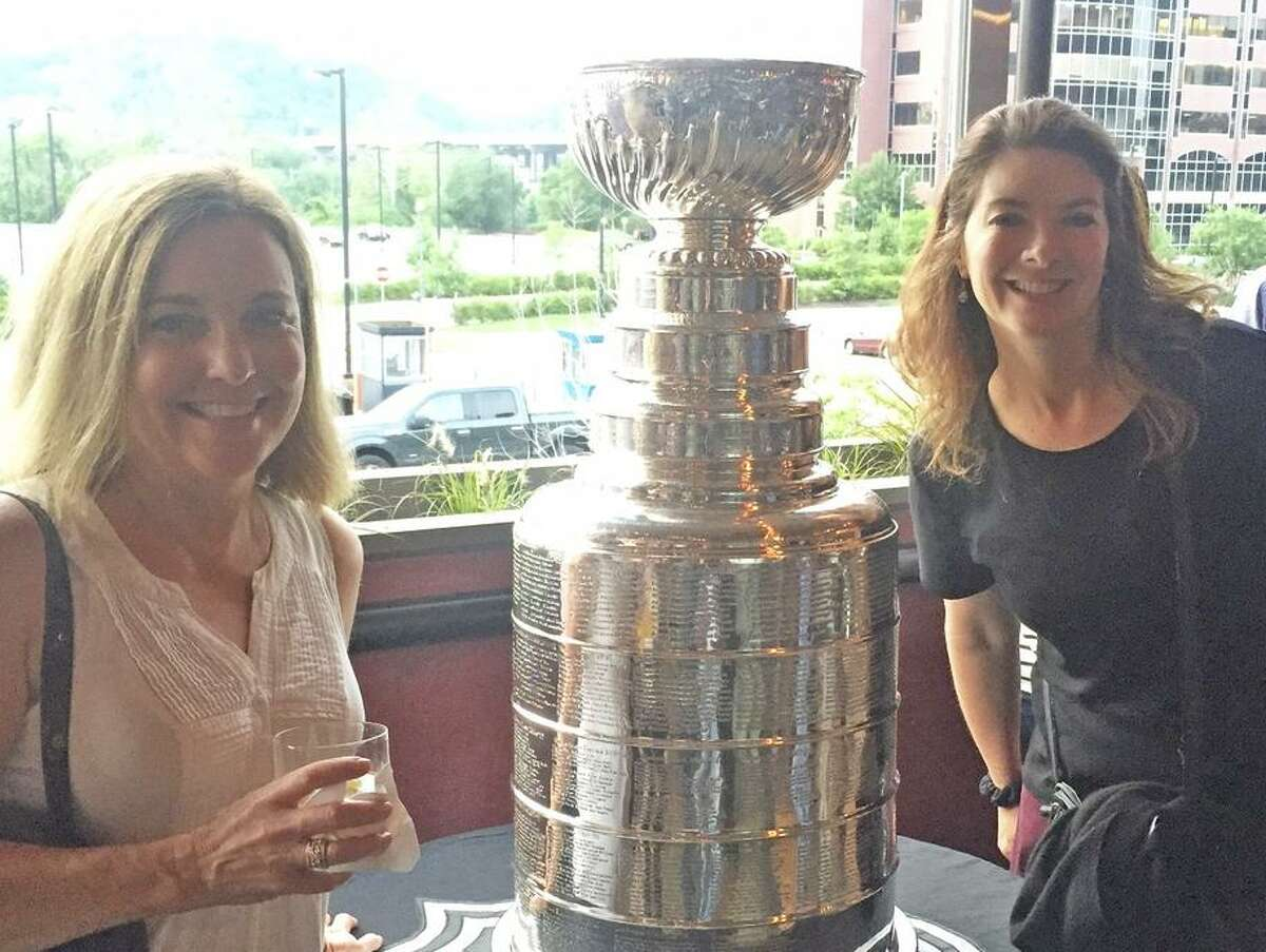 Chronicle columnist Ann Killion (left) and staff writer Susan Slusser with the Stanley Cup in Pittsburgh in 2016.