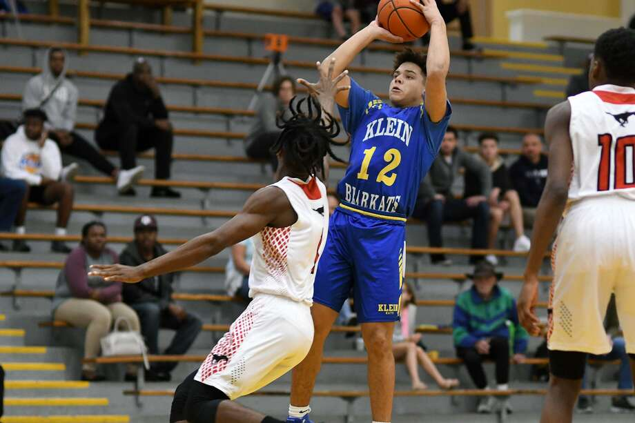 Klein sophomore Aaron Hutchinson (12) goes up for a shot over Westfield junior Lonzo Rand, left, during their matchup at the 54th Annual Conroe Christmas Classic at Conroe High School on Dec. 28, 2018. Photo: Jerry Baker, Houston Chronicle / Contributor / Houston Chronicle