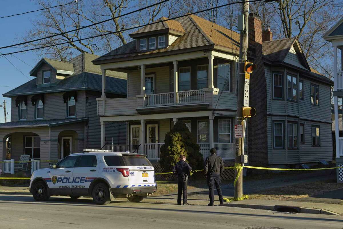 Police are seen outside the building located at 491 Pawling Ave., on Monday, Jan. 14, 2019, in Troy, N.Y. Police are investigating the death of a local woman, whose body was found at this location on Sunday. (Paul Buckowski/Times Union)
