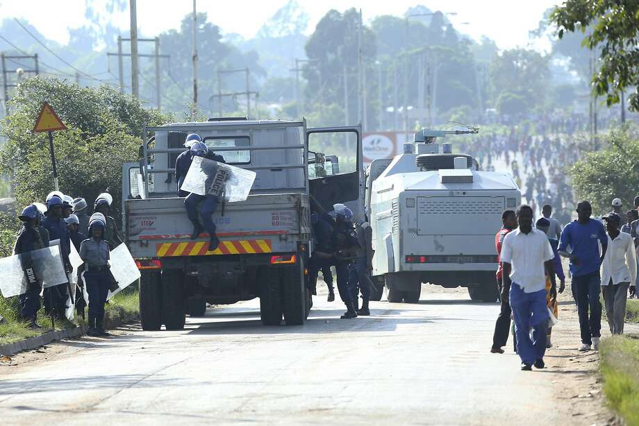 Riot police assemble at a protest in the capital of Harare against fuel prices that more than doubled over the weekend. The government also used military forces to disperse the rallies. Photo: Tsvangirayi Mukwazhi / Associated Press