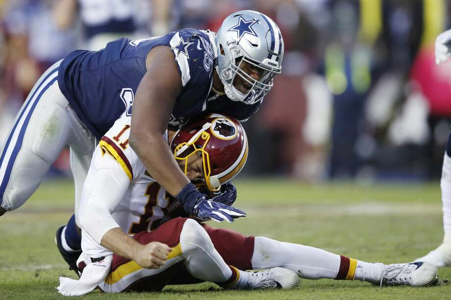LANDOVER, MD - OCTOBER 21: David Irving #95 of the Dallas Cowboys sacks Alex Smith #11 of the Washington Redskins during the game at FedExField on October 21, 2018 in Landover, Maryland. The Redskins won 20-17. (Photo by Joe Robbins/Getty Images) Photo: Joe Robbins/Getty Images