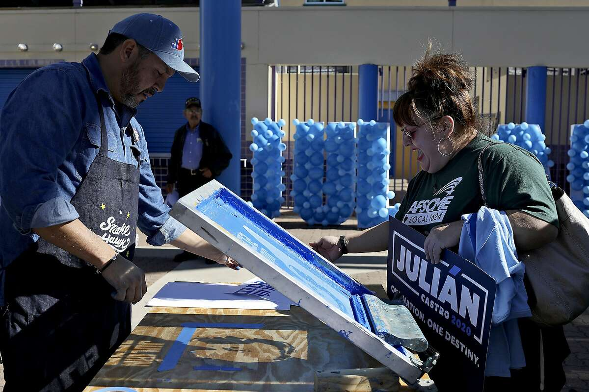 Cruz Ortiz creates posters of Juli‡n Castro, former HUD Secretary and former mayor of San Antonio, on a screen printing press, for supporters including Yvonne Flores, of Austin, after Castro announced his run for President of the United States at Plaza Guadalupe in San Antonio on Saturday, Jan. 12, 2019.