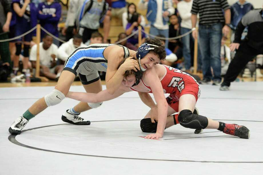 Jackson Crandall of Katy HS and Christian Lopez of Westside compete in the boys 106-pound weight class during the Region III 6-A UIL Wrestling Championships on Saturday, Feb. 17, 2018, at Paetow High School in Katy. Photo: Craig Moseley, Staff / Houston Chronicle / ©2018 Houston Chronicle