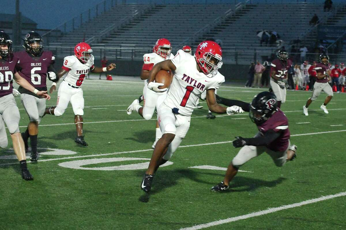 Alief Taylor's Khambrail Winters (1) tries to outrun Pearland's Will Hiers (15) Friday, Sep. 27 at Pearland High School.