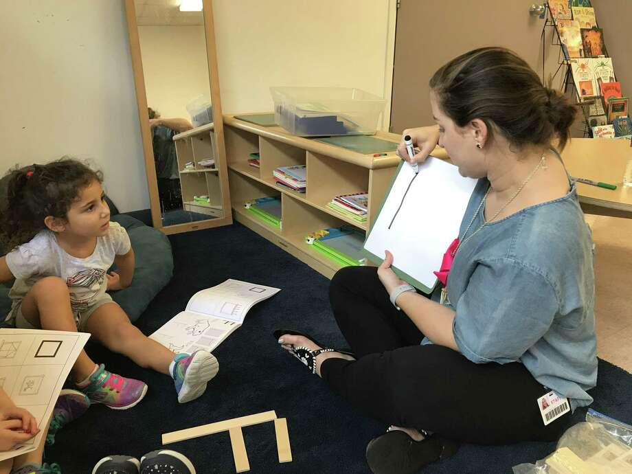 Teacher Emily Smith works with Pre-K student Naomi Faig as she learns about the letter F as part of the Handwriting without Tears curriculum. Photo: Courtesy Photo