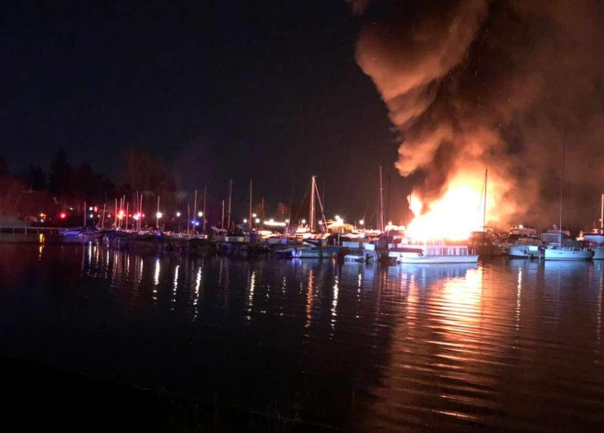 Multiple boats were damaged in a fire at a marina on Lake Washington Sunday night.