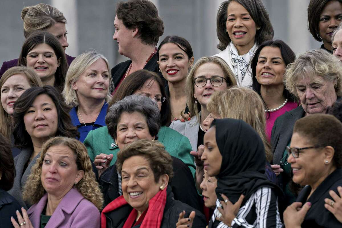 Rep. Alexandria Ocasio-Cortez, D-N.Y. (top center) stands for a photograph with House Democratic women members of the 116th Congress in Washington on Jan. 4, 2018.