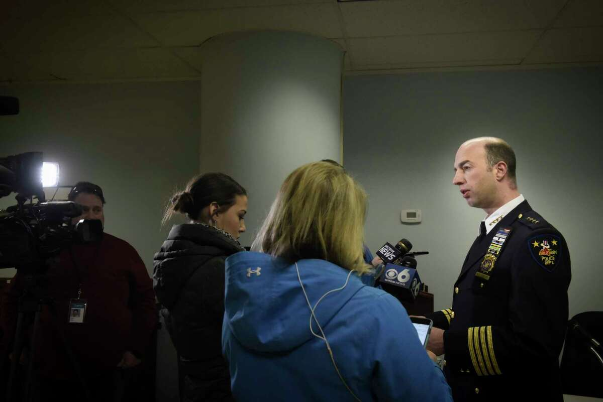 Troy Police Chief Brian Owens, right, talks to members of the media at City Hall about the homicide investigation taking place at 491 Pawling Ave., on Monday, Jan. 14, 2019, in Troy, N.Y. Police are investigating the death of a local woman, whose body was found at the Pawling Ave. location on Sunday. (Paul Buckowski/Times Union)