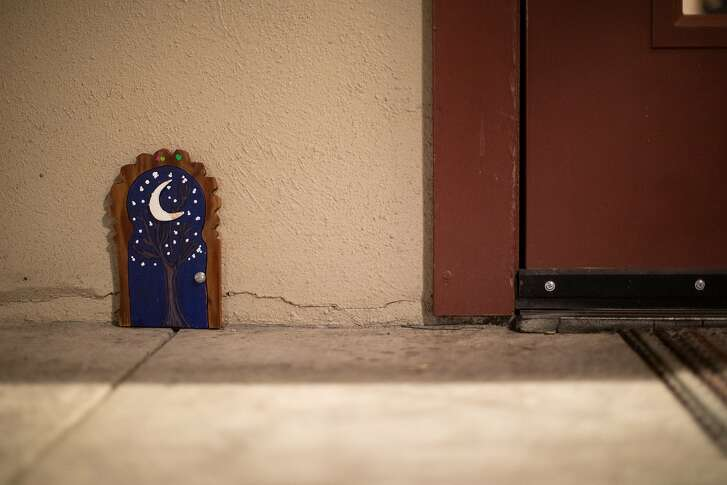 A  tiny fairy door sits between two stores on Healdsburg Ave. on Thursday, Jan. 10, 2019, in Healdsburg, CA.