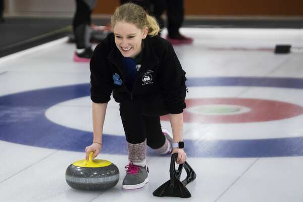 Kristin O'Donnoghue demonstrates how to throw a stone in curling during an open house at the Midland Curling Club on Saturday, Jan. 12, 2019. (Katy Kildee/kkildee@mdn.net)