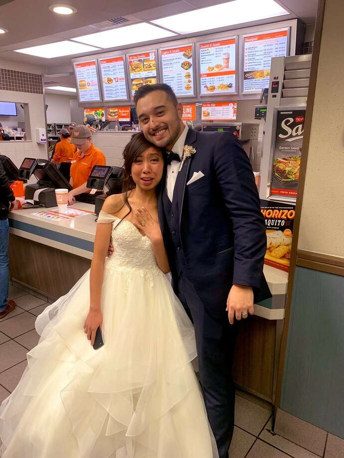 Jordan and Arianne Moore had a traditional church wedding on January 11, 2019. After walking down the aisle, they decided to do it again - inside a Whataburger. Photo: Jackie White