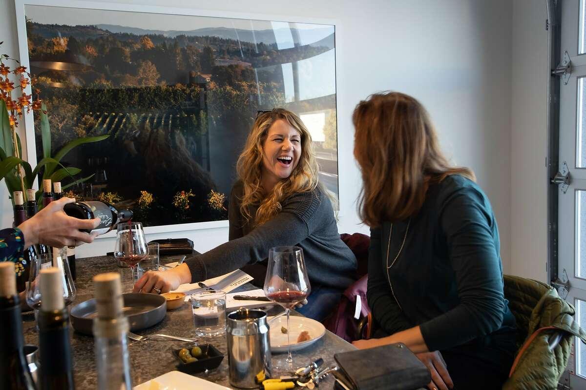 Alethea Behrens and Heather Wilson enjoy a private wine tasting at Grand Cru Custom Crush on Saturday, Jan. 12, 2019, in Healdsburg, Calif.