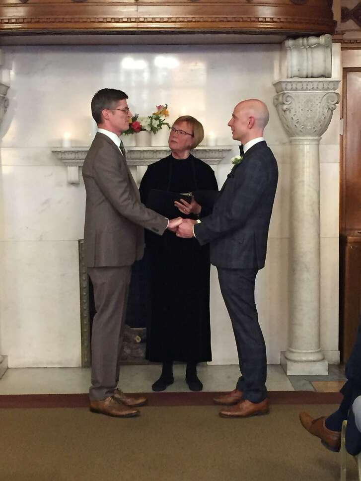 Greg Scanlan (left) and Brad Althoff were married by minister Mary Albing.