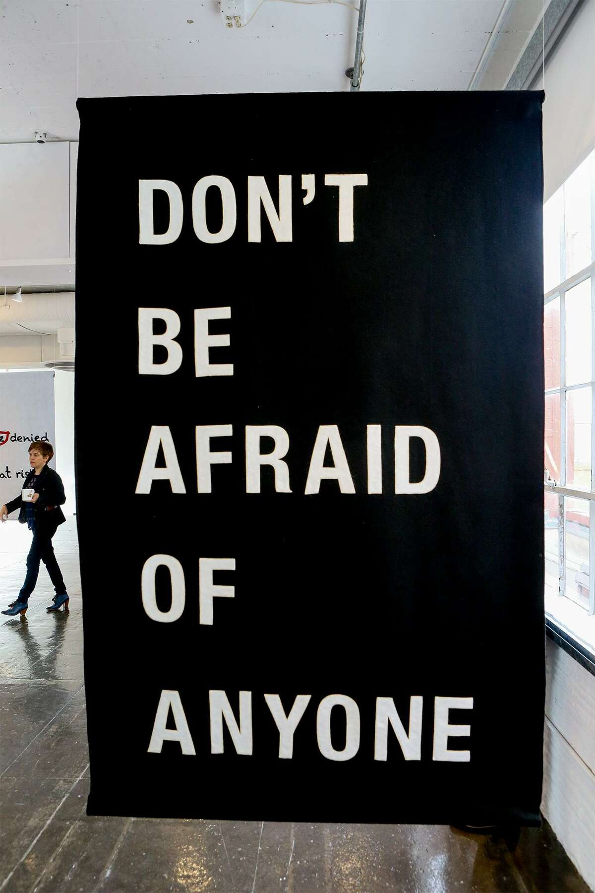 """Multi-disciplinary artist Laurie Anderson collaborated with writer A.M. Homes on this banner, which is featured in """"Word on the Street."""" The exhibit is on display at Artpace, marking its first showing outside of New York."""