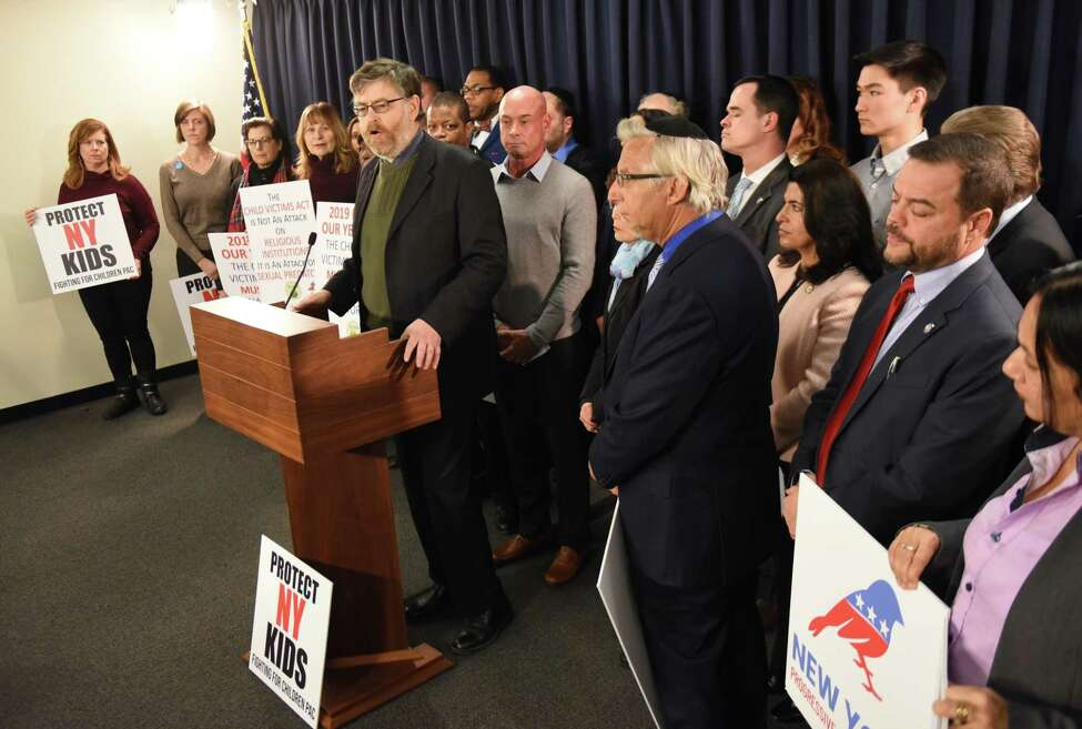 Gary Greenberg, a New York businessman and founder of Fighting for Children PAC, center, speaks during a press conference to bring attention to the Child Victims Act on Monday, Jan. 14, 2019, at the Legislative Office Building in Albany, N.Y. Greenberg has waged a years-long effort advocating New York lawmakers to pass the Child Victims Act. He said he was raped as a 7-year-old boy by a hospital worker. The Child Victims Act expected to pass this month after being blocked by Senate GOP for years. (Will Waldron/Times Union)