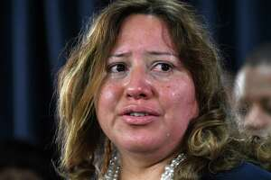 Connie Altamirano, who said she was raped by her grandmotherÕs second husband as a toddler, broke down in tears during a press conference to bring attention to the Child Victims Act on Monday, Jan. 14, 2019, at the Legislative Office Building in Albany, N.Y. The Child Victims Act expected to pass this month after being blocked by Senate GOP for years. (Will Waldron/Times Union)