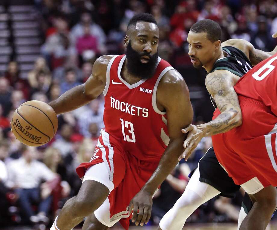 Houston Rockets guard James Harden (13) takes the ball past a pick by forward Gary Clark (6) against the Milwaukee Bucks during the first half of an NBA basketball game at Toyota Center on Wednesday, Jan. 9, 2019, in Houston. Photo: Brett Coomer, Houston Chronicle / Staff Photographer / © 2019 Houston Chronicle