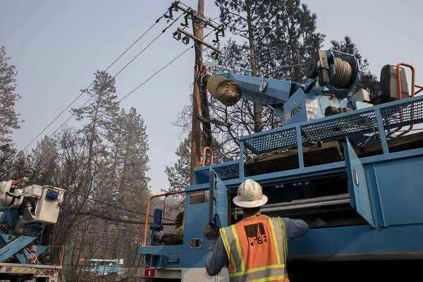 1d1f77381 1of3PG E crews work to clear downed power lines and telephone poles in  Paradise