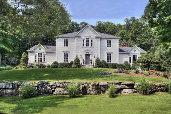 The elegant modern colonial house at 10 Dogwood Lane sits on a one-acre property in the private Tokeneke Association.
