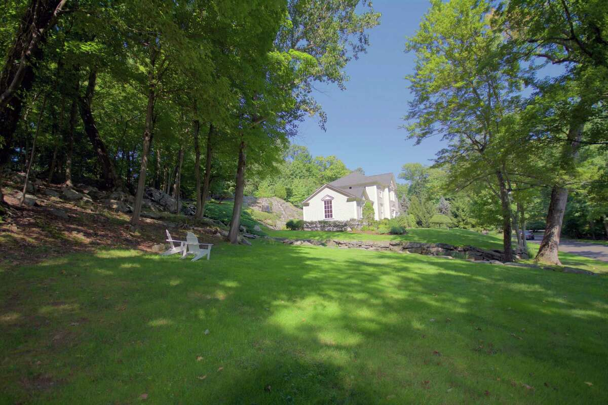 This 3,652-square-foot house sits on a one-acre property in the private Tokeneke Association.