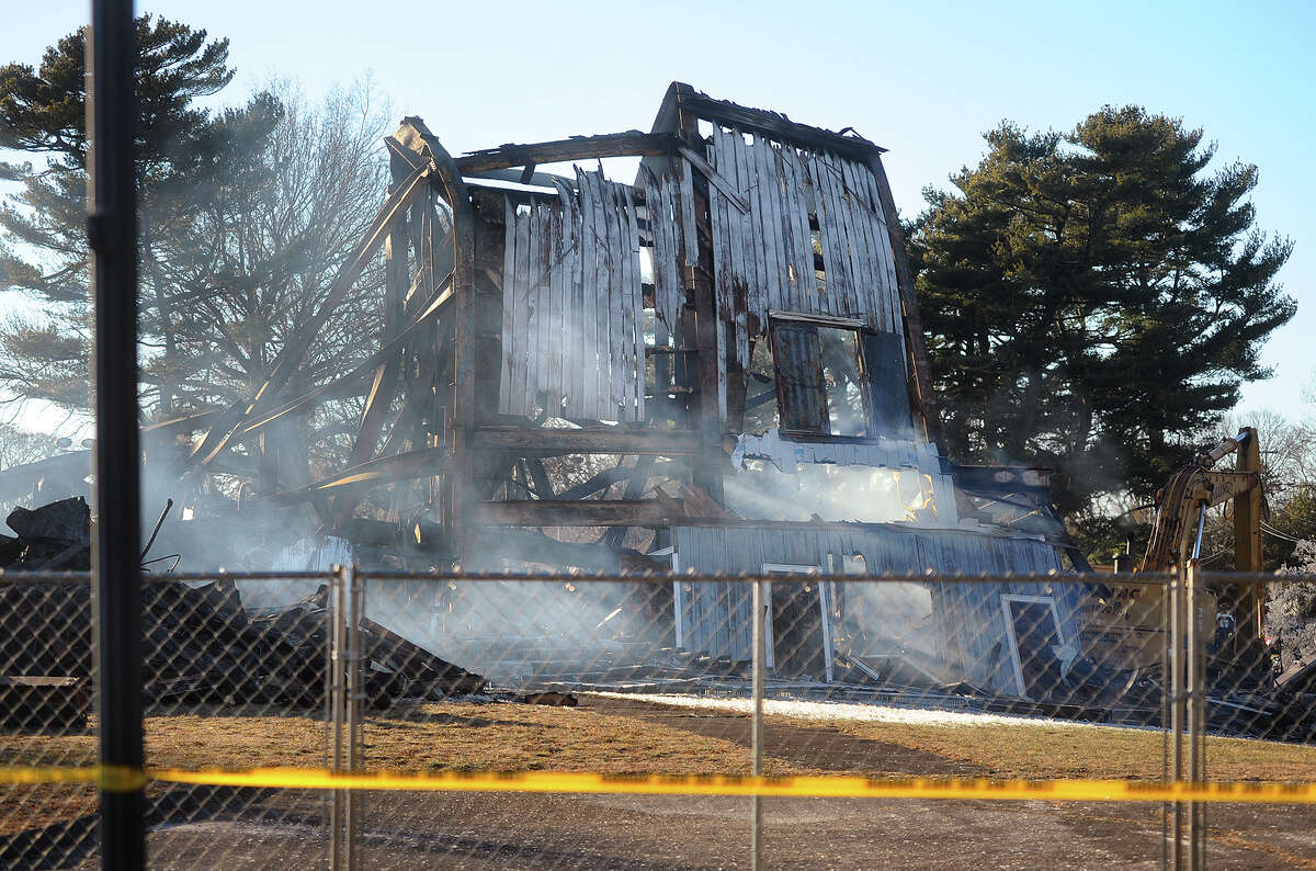 Smoke rises from the remains of the Shakespeare Theater in Stratford, Conn. on Monday, January 14, following a fire early Sunday morning that engulfed the structure.