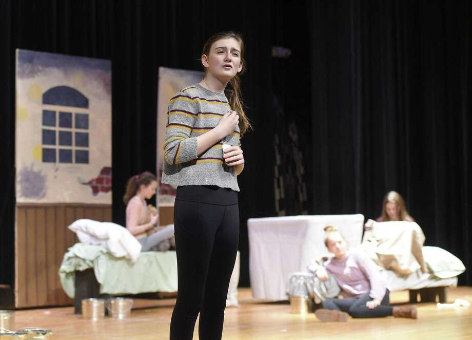 "Molly Krisky plays the lead role of Annie during the rehearsal of ""Annie"" at Eastern Middle School in the Riverside section of Greenwich, Conn. Tuesday, Jan. 8, 2019. The performance takes place Jan. 17 at 4:30 p.m., Jan. 18 at 7:30 p.m., and Jan. 19 at 7:30 p.m. Photo: Tyler Sizemore / Hearst Connecticut Media / Greenwich Time"