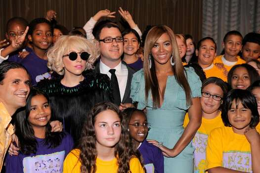 NEW YORK - OCTOBER 02:  Musician Lady Gaga, Billboard Magazine Editor and Cheif Bill Werde and singer Beyonce pose the childrens chorous from P.S. 22 at Billboard's 4th Annual Women In Music event at The Pierre Hotel on October 2, 2009 in New York City.  (Photo by Jemal Countess/Getty Images) *** Local Caption *** Lady Gaga;Bill Werde;Beyonce Photo: Jemal Countess, Getty Images / 2009 Getty Images