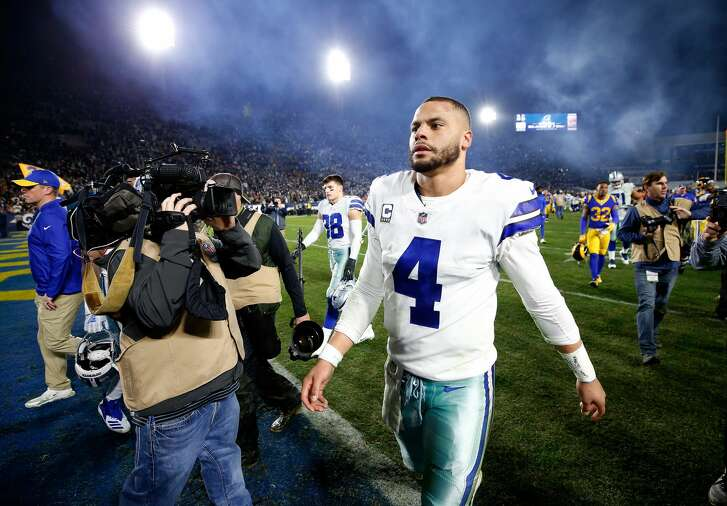 LOS ANGELES, CA - JANUARY 12:  Dak Prescott #4 of the Dallas Cowboys walks off the field after being defeated by the Los Angeles Rams in the NFC Divisional Playoff game at Los Angeles Memorial Coliseum on January 12, 2019 in Los Angeles, California. The Rams defeated the Cowboys 30-22.  (Photo by Sean M. Haffey/Getty Images)