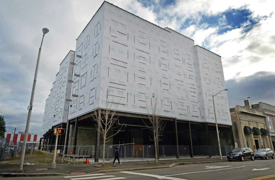 The stalled redevelopment project known as Wall Street Place Tuesday, November 27, 2018, along Wall Street in Norwalk, Conn. Citibank acquired the former Isaacs Street municipal lot after Port Chester, N.Y.-based developer POKO Partners halted construction on phase one of Wall Street Place in 2016. Norwalk William D. Ireland, Norwalk's Chief Building Official and blight prevention officers met representatives of Citibank and Viking Construction at 'Tyvek Temple' on Tuesday to ensure that the bank is addressing issues raised in blight citation. Photo: Erik Trautmann / Hearst Connecticut Media / Norwalk Hour