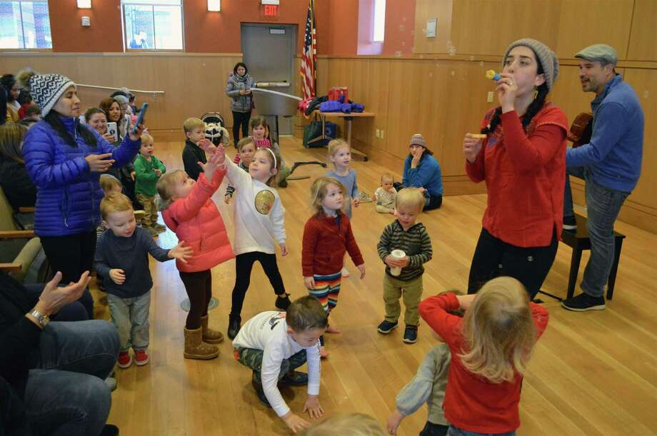 A bubble spectacular was among the happy moments at the Bilingual Birdies concert at Darien Library, Friday, Jan. 11, 2019, in Darien, Conn. Photo: Jarret Liotta / For Hearst Connecticut Media / Darien News Freelance