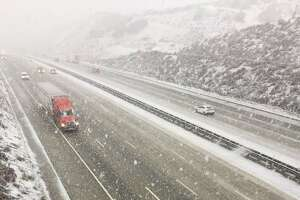 Snow fell on Interstate 5 over the Grapevine on Jan. 14, 2019.