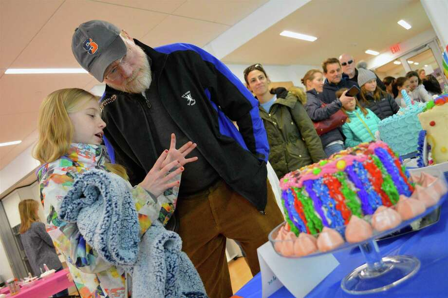 Ella Thomas, 11, of New Canaan tells her father, James, details about cake decorating at the New Canaan CARES' annual cake baking and decorating contest, held at the YMCA, Sunday, Jan. 13, 2019, in New Canaan, Conn. Photo: Jarret Liotta / For Hearst Connecticut Media / New Canaan News Freelance